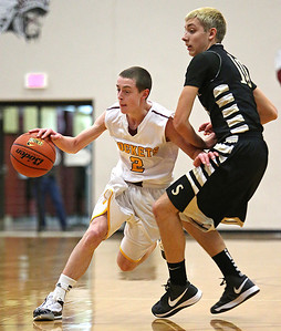 Brett Moist/ for the Northwest Herald    Richmond-Burton's Blaine Bayer drives past Sycamore's Nicholas Feuerbach during the 1st quarter of their day one matchup of the  64th annual E.C. Nichols basketball tournament at Marengo High School on Saturday.
