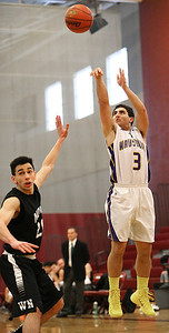 Brett Moist/ for the Northwest Herald    Wauconda's Joey Lovelle shoots a 3 point shot over Woodstock North's Riley Basaran during the 4th quarter of their day one matchup of the  64th annual E.C. Nichols basketball tournament at Marengo High School on Saturday.