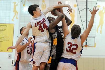 Jacobs junior guard Chris Orange fights through the defense of Lakes junior guard Zack Meyer and senior forward Jack Monson while attempting a basket  during their opening rounf game of the Hinkle Holiday Classic at Jacobs high school.
