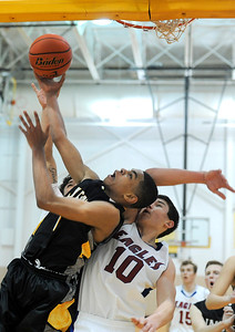Jacobs junior guard Kenton Mack goes for a lay up over Lakes junior forward Ethan Sage during their opening rounf game of the Hinkle Holiday Classic at Jacobs high school.