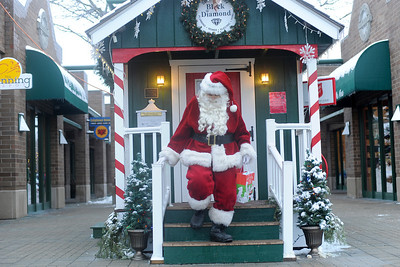 Santa Clause closes up the Santa House in downtown Crystal Lake,Il. after spending the day visiting with children Sunday December 22,2013 . The house, which opened in 2008, is open every weekend starting the week after Thanksgiving until the December 23rd.