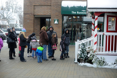 People wait in line in front  Santa House in downtown Crystal Lake,Il. on Sunday December 22,2013 . People waited between 30-40 minutes in line to meet Santa. The house, which opened in 2008, is open every weekend starting the week after Thanksgiving until the December 23rd.