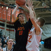 Batavia's Danny Pieczynski (10) drives to the hoop against St.Charles East's James McQuillan (22) at St.Charles East High School in St.Charles, IL on Saturday, December 21, 2013 (Sean King for Shaw Media)