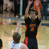 Batavia's Danny Pieczynski (10) puts up a shot against St.Charles East's Mick Vyral (11) at St.Charles East High School in St.Charles, IL on Saturday, December 21, 2013 (Sean King for Shaw Media)