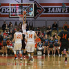 St.Charles East's AJ Washington (1) goes up for a break away dunk against Batavia during the third quarter of play at St.Charles East High School in St.Charles, IL on Saturday, December 21, 2013 (Sean King for Shaw Media)