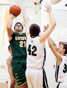 Sarah Nader- snader@shawmedia.com Crystal Lake South's Austin Rogers shoots during the third quarter of Thursday's game against Bartlett at the Hinkle Holiday Classic at Jacobs High School December 26, 2013. Crystal Lake South won, 46-43.