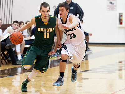 Sarah Nader- snader@shawmedia.com Crystal Lake South's Chris Mahoney (left) is guarded bye Bartlett's Tyler Pauletti while he brings the ball down court during the third quarter Thursday's game at the Hinkle Holiday Classic at Jacobs High School December 26, 2013. Crystal Lake South won, 46-43.