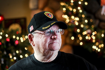 Sarah Nader- snader@shawmedia.com Vietnam veteran Pat Fimon of Crystal Lake poses for a portrait at Brink Street Restaurant in Crystal Lake Thursday, December 26, 2013. Fimom loaned his Purple Heart to the Brink Street Restaurant to help garner more donations in the Toys for Tots drive and to reach out to veterans who may need counseling services. Fimon has become a strong advocate for the military counseling provided in McHenry County after struggling with PTSD for decades before seeking help.