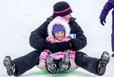 Sarah Nader- snader@shawmedia.com Colleen Nolan of Lake in the Hills holds her daughter, Lexa, 7, as they slide down the hill at Ted Spella Community Park in Algonquin Thursday, December 26, 2013.