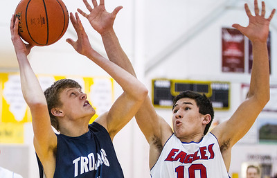 Kyle Grillot - kgrillot@shawmedia.com   Cary-Grove senior Michael Coleman (left) puts up a shot under the defense of Lakes junior Ethan Sage (10) during the second quarter of the semifinal match Friday at the Hinkle Holiday Classic at Jacobs in Algonquin. Cary-Grove won, 49-34.