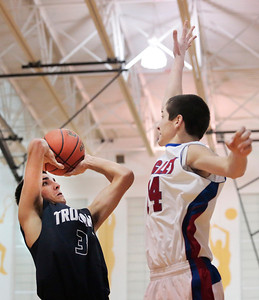 Kyle Grillot - kgrillot@shawmedia.com   Cary-Grove senior Tyler Szydlo (3) puts up a shot under the defense of Lakes senior TJ Edwards (24) during the third quarter of the semifinal match Friday at the Hinkle Holiday Classic at Jacobs in Algonquin. Cary-Grove won, 49-34.