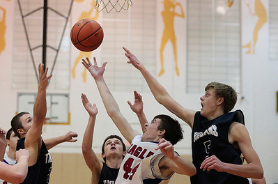 Kyle Grillot - kgrillot@shawmedia.com   Players including Cary-Grove senior Michael Coleman (5) and Lakes junior Zach Meyer  (44) jump for a rebound during the second quarter of the semifinal match Friday at the Hinkle Holiday Classic at Jacobs in Algonquin. Cary-Grove won, 49-34.