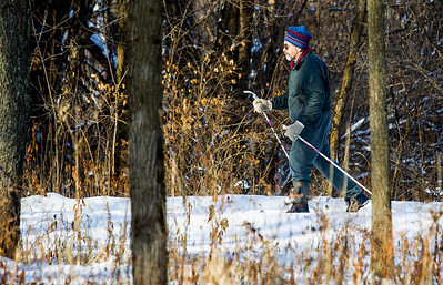 Kyle Grillot - kgrillot@shawmedia.com   Andrei Chugunov of Cary skies down a trail at Moraine Hills State Park Friday in McHenry. After 4 inches of snow accumulates, the McHenry County Conservation District grooms over 40 miles of cross-country ski trails at 19 different sites throughout the county. Moraine Hills State Park offers more than 10 miles of trails through the park created by glacial deposits. Seasonal habitation of the park area extends back to approximately 4,000 B.C.