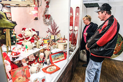 Sarah Nader- snader@shawmedia.com Kevin Ellison and Lonni Oldham both of Huntley, look at the 1950's- 60's holiday display at the McHenry County Historical Society and Museum in Union December 27, 2013.  Society board member Dave Harms of Crystal Lake, with the help of antique dealer Lynne Eltrevoog of Marengo, compiled the must-see display featuring a selection of rare, vintage radios – including one honoring Mickey Mantle and Roger Maris, plus a working 1951 Rudolph the Red Nosed Reindeer model. The display is meant to re-create the feel of a 1950s streetscape.