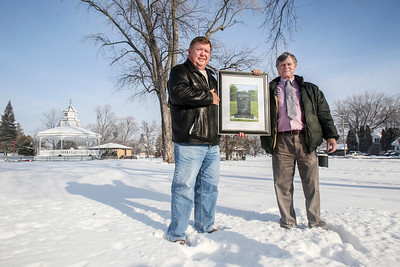 Sarah Nader- snader@shawmedia.com Vietnam veterans Ron Fuhler (left) of Crystal Lake and Rich Phannenstill of Racine, Wis., pose for a portrait on Friday, December 27, 2013 holding a picture of the Vietnam memorial that will be installed at Veterans Memorial Park in McHenry