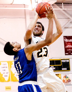 Sarah Nader- snader@shawmedia.com Larkin's Christian Negron (left) guards Jacobs' Ben Murray while he shoots during the second quarter  of Saturday's game at the Hinkle Holiday Classic at Jacobs in Algonquin December 28, 2013. Jacobs was defeated, 47-56.