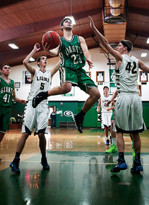 Kyle Grillot - kgrillot@shawmedia.com   Alden-Hebron senior Avi Mor puts up a shot during the fourth quarter of the Christmas Tournament game against Harvest Christian Monday in Hebron. Alden-Hebron lost, 46-33.