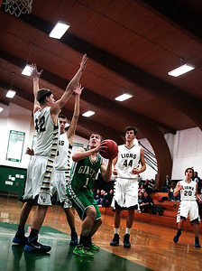 Kyle Grillot - kgrillot@shawmedia.com   Heavily defended Alden-Hebron junior Cody Nelson (1) puts up a shot during the fourth quarter of the Christmas Tournament game against Harvest Christian Monday in Hebron. Alden-Hebron lost, 46-33.