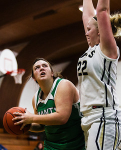 Kyle Grillot - kgrillot@shawmedia.com   Alden-Hebron junior Hannah Bhehrens (45) puts up a shot under the defense of Harvest Christian sophomore Rachel Oostdyk (22) during the first quarter of the Christmas Tournament game against Harvest Christian  Monday in Hebron. Alden-Hebron won, 50-43.