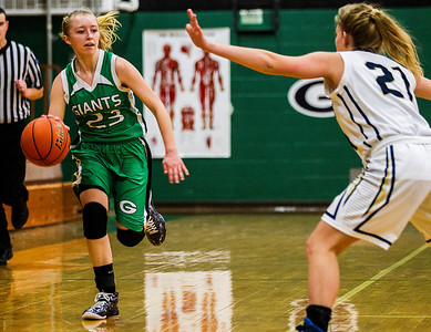 Kyle Grillot - kgrillot@shawmedia.com   Alden-Hebron freshman Tally Lalor (23) dribbles up court under the defense of Harvest Christian senior Aliyah Ellis during the second quarter of the Christmas Tournament game against Harvest Christian  Monday in Hebron. Alden-Hebron won, 50-43.