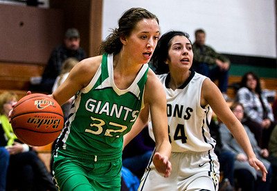 Kyle Grillot - kgrillot@shawmedia.com   Alden-Hebron senior Brooklyn Hilton dribbles towards the net under the defense of Harvest Christian sophomore Cellie Carrillo (34) during the first quarter of the Christmas Tournament game against Harvest Christian  Monday in Hebron. Alden-Hebron won, 50-43.