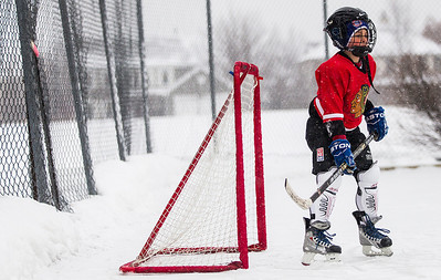 "Kyle Grillot - kgrillot@shawmedia.com   Aidan Newett, 10, of Algonquin plays as the goalie while playing hockey at Willoughby Farms Park Tuesday in Algonquin. ""This is basically my home court"" Newett said, ""I'm here every day."""