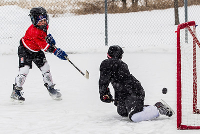 "Kyle Grillot - kgrillot@shawmedia.com   Aidan Newett, 10, of Algonquin takes a shot at Marcos Lopez, 9, while playing hockey at Willoughby Farms Park Tuesday in Algonquin. ""This is basically my home court"" Newett said, ""I'm here every day."""