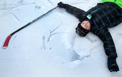 Kyle Grillot - kgrillot@shawmedia.com   Miguel Lopez, 13, of Algonquin takes a break from playing hockey with his brother at Willoughby Farms Park Tuesday in Algonquin.