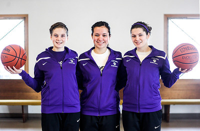 Sarah Nader- snader@shawmedia.com Hampshire basketball players, Nikki Dumoulin (left), 16, Becky Dumoulin, 17, and Tricia Dumoulin, 17, pose for a portrait in Hampshire Tuesday, December 31, 2013. The two sisters and their cousin come from a long line of Dumoulins to play basketball at Hampshire.