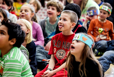 Sarah Nader- snader@shawmedia.com Hunter Johanson (center), 7, of Woodstock watches a performance by RC Juggle before counting down to noon during the 5th annual Kids Bash at Crosby Elementary School in Harvard Tuesday, December 31, 2013. Children celebrated New Year's Eve with games, crafts, face painting, music and a countdown to noon with Mayor Jay Nolan.
