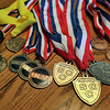Jeff Krage – For Shaw Media<br /> A collection of medals won by Madison, Michael and Megan Ronzone in both track and cross-country.<br /> Batavia 12/20/14