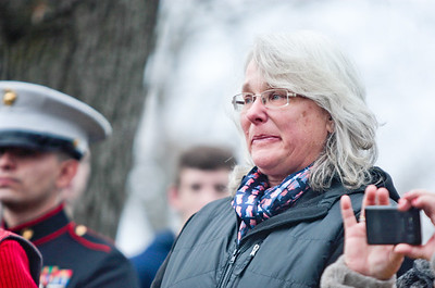 Michelle LaVigne/ For Shaw Media Sandy Barcus of McHenry is emotional after placing a wreath honoring the Gold Star families during a ceremony at the McHenry VFW post 4600 on Saturday December 12, 2015. The ceremony was held prior to volunteers hanging wreaths on the graves of veterans in the St. Mary of the Assumption Church, Woodlawn and  Johnsburg Baptist Church cemeteries in conjunction with the wreathes across America program. Barcus lost her son, Army Pfc. Collier Barcus in 2004 after he died during a mortar attack in Baghdad.