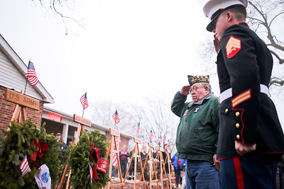 Michelle LaVigne/ For Shaw Media Marine Veteran Robert Lungren of McHenry and marine Sgt. Andrew Lowery of McHenry, salute the wreath they laid in honor of marine branch during a ceremony held at McHenry VFW 4600  in McHenry, Ill.  on Saturday December 12, 2015 in conjunction with the wreaths across America program. Following the ceremony volunteers placed wreaths on the graves of veterans at St. Mary of the Assumption Church, Woodlawn and Johnsburg Baptist Church cemeteries.