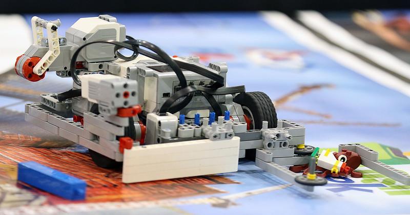 "Jeff Krage – For Shaw Media<br /> A Lego robot works on removing trash during Saturday's Lego League 2015 ""Trash Trek"" Challenge at Rotolo Middle School in Batavia.<br /> Batavia 12/19/15"