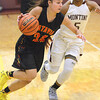 Mark Busch - mbusch@shawmedia.com<br /> Batavia's Elena Cabrera drives around a defender during their game against Montini at the 7th annual Montini Girls Basketball Christmas Tournament Monday Dec. 28.