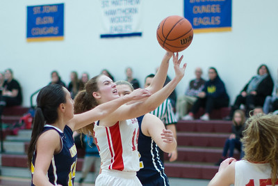 Faith Lutheran's Alyssa Pedersen (14) puts up a shot through the Luther North defense Monday Dec. 5, 2016 at Immanuel Lutheran School in Crystal Lake. Luther North went on to win 70-17. KKoontz-for Shaw Media