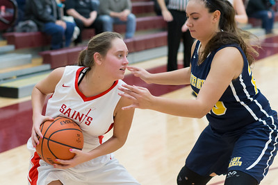 Faith Lutheran's Ariana Sauder (Left) drives the baseline against Luther North Monday Dec. 5, 2016 at Immanuel Lutheran School in Crystal Lake. Luther North went on to win 70-17. KKoontz-for Shaw Media