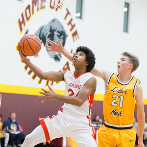 Faith Lutheran's Jorden Warrener (24) drives past the Luther North defense Monday Dec. 5, 2016 at Immanuel Lutheran School in Crystal Lake. Luther North went on to win 78-42. KKoontz-for Shaw Media