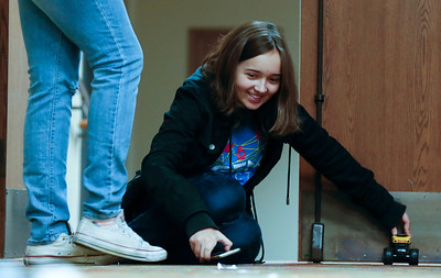 """Emma Hartman, an 8th grader at Lundahl Middle School uses a toy car for a graphing project during a mentoring session for the """"Stem is Fair Game"""" Science Fair at the Crystal Lake Library on Saturday, December 3, 2016 in Crystal Lake. STEM IS FAIR GAME is geared toward encouraging and inspiring girls to explore their interests in STEM fields through research. John Konstantaras photo for the Northwest Herald"""