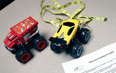 """John Konstantaras - For Shaw Media Toy cars are used for a graphing project during a mentoring session for the """"Stem is Fair Game"""" Science Fair at the Crystal Lake Library on Saturday, December 3, 2016 in Crystal Lake."""