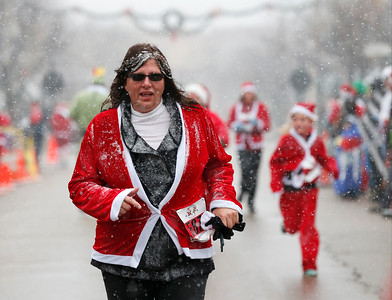 Christina Coclanis-Loding heads to the finish line during the 5k run at the 5th annual Santa Run on Sunday, December 4, 2016 in Crystal Lake. The run benefits Kiwanis Club of Crystal Lake, Turning Point, CASA, Girls on the Run of NW IL, Big Brothers Big Sisters, and Main Stay Therapeutic Riding. John Konstantaras photo for the Northwest Herald