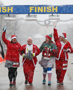(L-R) Rhonda Baumgartner, from Volo, Sandy Sowa, from Northlake, Crystle Schneider, from Carpentersville, and Jennifer Battaglia, from Crystal Lake, head to the finish of the 5k run in the 5th annual Santa Run on Sunday, December 4, 2016 in Crystal Lake. The run benefits Kiwanis Club of Crystal Lake, Turning Point, CASA, Girls on the Run of NW IL, Big Brothers Big Sisters, and Main Stay Therapeutic Riding. John Konstantaras photo for the Northwest Herald