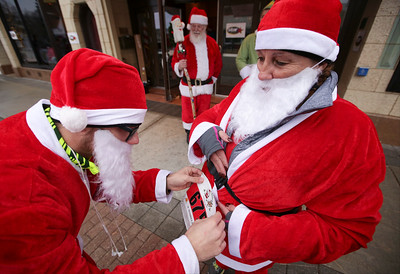 Jake Gerberm left, helps his mom Sue Gerber with her number before the 5th annual Santa Run on Sunday, December 4, 2016 in Crystal Lake. The run benefits Kiwanis Club of Crystal Lake, Turning Point, CASA, Girls on the Run of NW IL, Big Brothers Big Sisters, and Main Stay Therapeutic Riding. John Konstantaras photo for the Northwest Herald