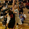 Kaneland's Grace Ringel puts the shot up over La Salle-Peru's Kamryn Olson on Dec. 3 at Kaneland.