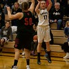 Kaneland's Jennie Weber shoots the ball over La Salle - Peru's Zoey Piano on Dec. 3 at Kaneland.