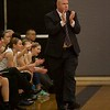Kaneland's Coach Ernie Colombe applauds the play against La Salle-Peru on Dec.3 at Kaneland.