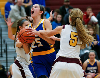 Kayla Stefka (25) of Johnsburg is fouled as she drives on Breanne Retherford (5) of Richmond-Burton during the third quarter of their game at Richmond-Burton High School  on Tuesday, December 6, 2016 in Richmond. The Skyhawks defeated the Rockets 40-24. John Konstantaras photo for the Northwest Herald