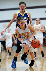 KC Davids (10) of Richmond-Burton is fouled as she chases down a loose ball in front of Kayla Stefka (25) of Johnsburg during the fourth quarter of their game at Richmond-Burton High School  on Tuesday, December 6, 2016 in Richmond. The Skyhawks defeated the Rockets 40-24. John Konstantaras photo for the Northwest Herald