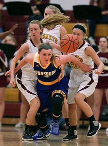 Megan Madsen (4) of Johnsburg breaks free from Richmond-Burton defenders as she chases down a loose ball during the third quarter of their game at Richmond-Burton High School  on Tuesday, December 6, 2016 in Richmond. The Skyhawks defeated the Rockets 40-24. John Konstantaras photo for the Northwest Herald