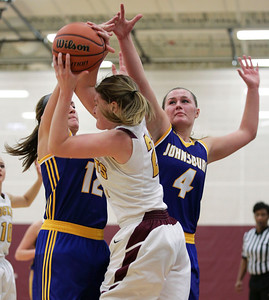 Morgan Madsen (12) and Megan Madsen (4) of Johnsburg  pressure Mackenzie Hahn (23) of Richmond-Burton during the second quarter of their game at Richmond-Burton High School  on Tuesday, December 6, 2016 in Richmond.  John Konstantaras photo for the Northwest Herald